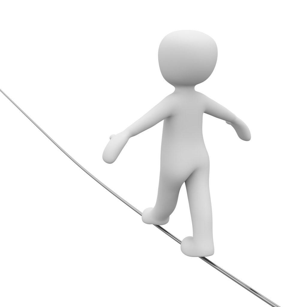 Man walking a tight rope